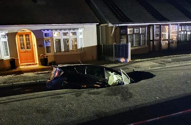 The massive hole appeared in the early hours of Monday morning as Storm Ciara raged, wreaking havoc across the UK. (SWNS)