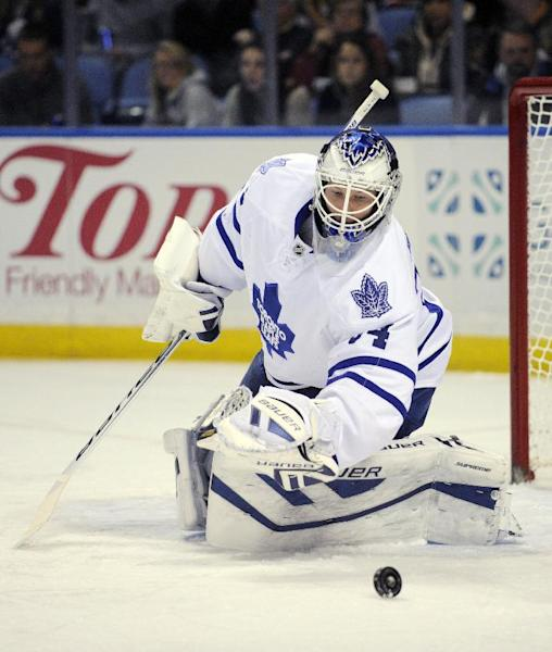 Toronto Maple Leafs goaltender James Reimer keeps an eye on a rebound during the first period of an NHL hockey game against the Buffalo Sabres' in Buffalo, N.Y., Friday, Nov. 29, 2013. (AP Photo/Gary Wiepert)