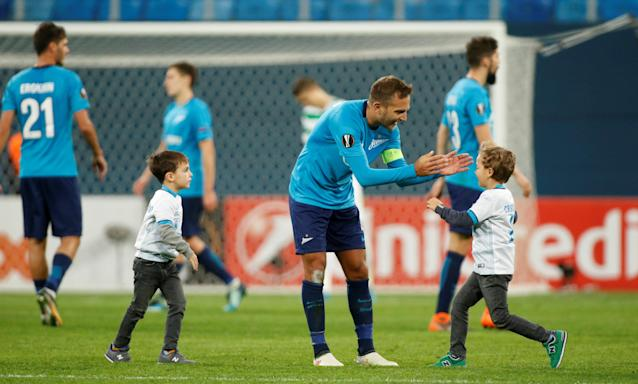 Soccer Football - Europa League Round of 32 Second Leg - Zenit Saint Petersburg vs Celtic - Stadium St. Petersburg, Saint Petersburg, Russia - February 22, 2018 Zenit St. Petersburg's Domenico Criscito celebrates with his children after the match REUTERS/Maxim Shemetov