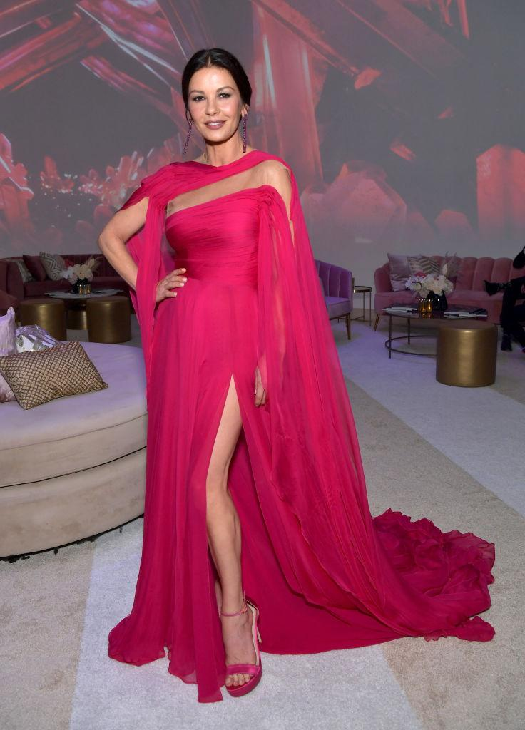 Catherine Zeta-Jones donned a hot-pink dress with thigh-high split to attend the 2019 Netflix Primetime Emmy Awards After Party in 2019. (Photo by Emma McIntyre/Getty Images for Netflix)