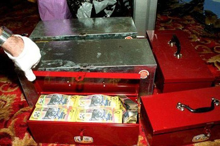 More than $4 million of the stolen money was found under the floorboards at a Kilburn home. Photo: SA Police