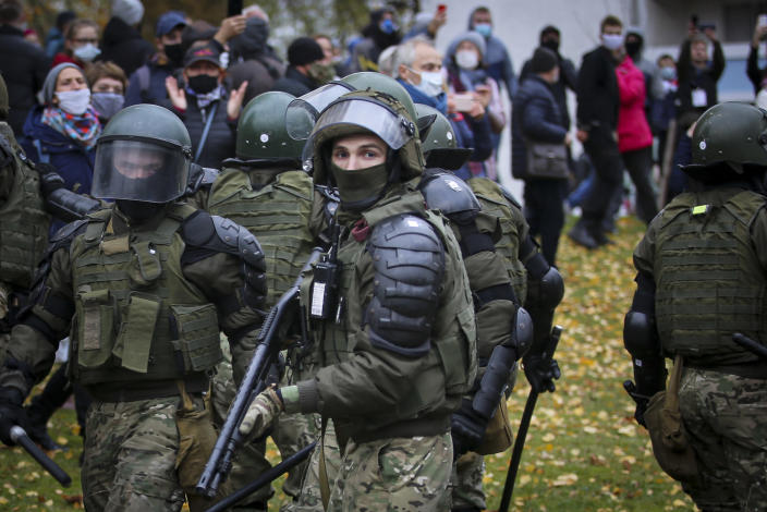 FILE - In this Nov. 1, 2020, file photo, armed police block demonstrators during an opposition rally to protest the official presidential election results in Minsk, Belarus. The diversion of a Ryanair flight to Lithuania by Belarus, leading to the arrest of Raman Pratasevich, an opposition journalist who was a passenger, has sparked international outrage and calls for tough sanctions against the former Soviet nation. Pratasevich ran a popular messaging app that helped organize the demonstrations. (AP Photo/File)