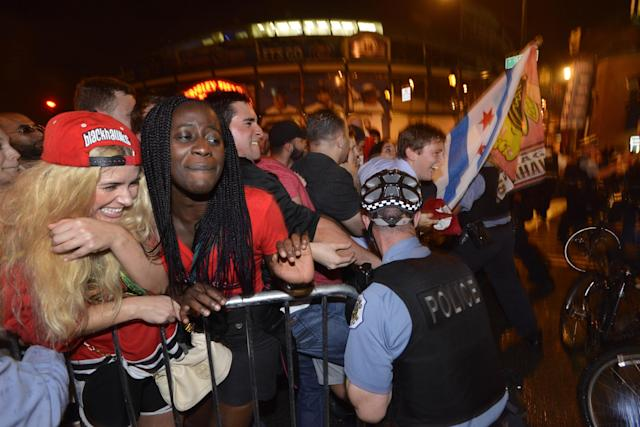 Chicago Blackhawks fans are pushed up against a barricade while celebrating on Clark street in the Wrigleyville neighborhood after the Chicago Blackhawks won the Stanley Cup, defeating the Tampa Bay Lightning in Chicago on Monday, June 15, 2015. (AP Photo/Paul Beaty)