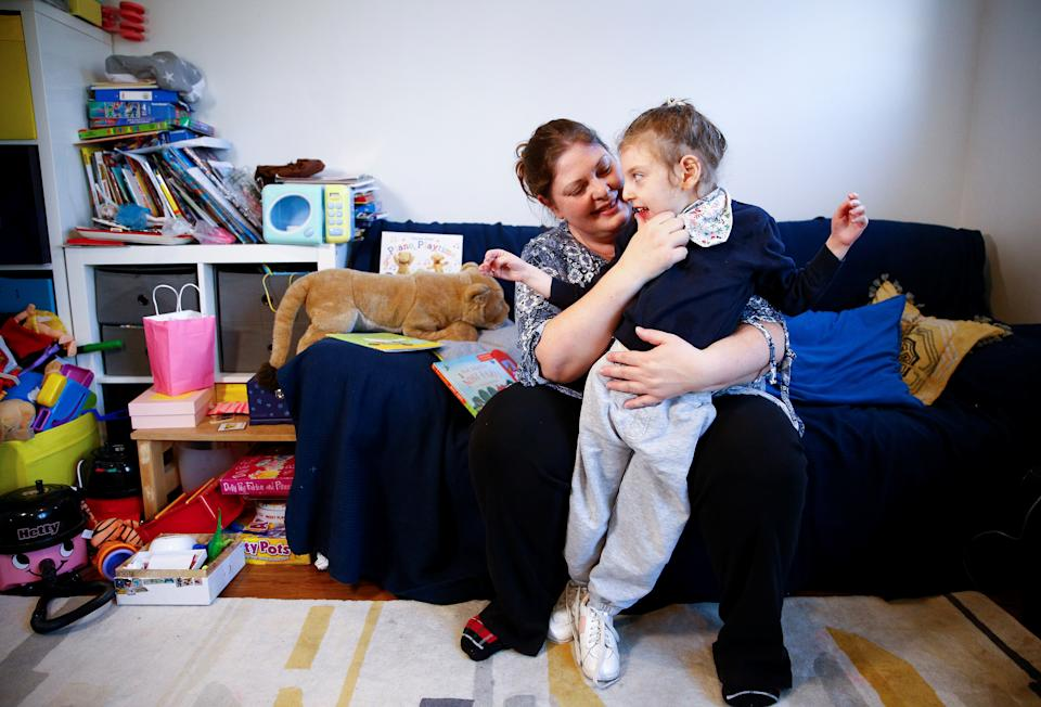 Jo Elgarf holds her daughter Nora at their home in London, Britain, January 30, 2019. Picture taken January 30, 2019. REUTERS/Henry Nicholls