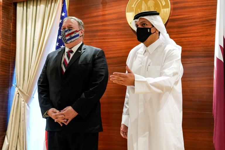 US Secretary of State Mike Pompeo, on what is likely his last official trip, meets with Qatar's Foreign Minister Mohammed bin Abdulrahman Al-Thani in November 2020
