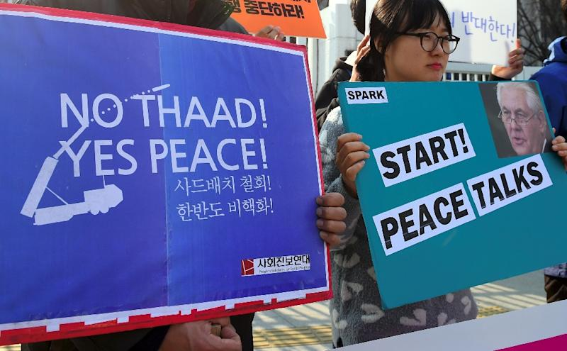 South Korea's anti-war activists hold placards during a rally against the planned deployment of the US-built Terminal High Altitude Area Defense (THAAD) anti-ballistic missile system