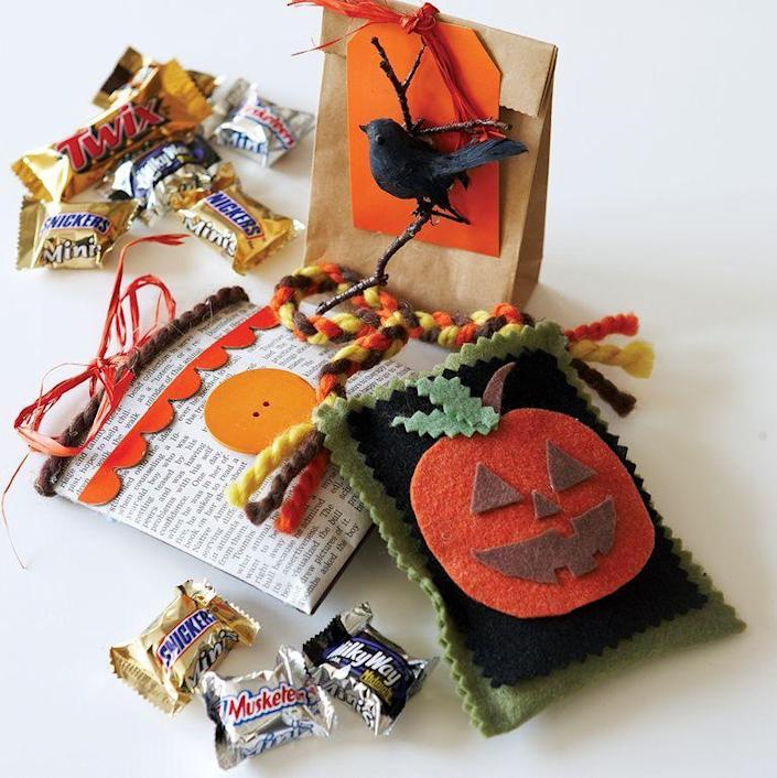 """<p>If you're looking for brand new ideas for your goody bags, decorate them with felt, newspaper, or construction paper.</p><p><em><strong><a href=""""https://www.womansday.com/home/crafts-projects/a28581509/frilly-favors/"""" rel=""""nofollow noopener"""" target=""""_blank"""" data-ylk=""""slk:Get the Frilly Favors tutorial"""" class=""""link rapid-noclick-resp"""">Get the Frilly Favors tutorial</a>.</strong></em></p><p><strong><a class=""""link rapid-noclick-resp"""" href=""""https://www.amazon.com/JISTL-Professional-Dressmaking-Scissors-Handheld/dp/B06XJT648N?tag=syn-yahoo-20&ascsubtag=%5Bartid%7C10070.g.1908%5Bsrc%7Cyahoo-us"""" rel=""""nofollow noopener"""" target=""""_blank"""" data-ylk=""""slk:SHOP PINKING SHEARS"""">SHOP PINKING SHEARS</a><br></strong></p>"""