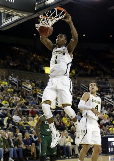 Michigan forward Glenn Robinson III dunks against Cleveland State during the first half of their NCAA college basketball game in the second-round of the NIT Season Tip-Off tournament in Ann Arbor, Mich., Tuesday, Nov. 13, 2012. (AP Photo/Paul Sancya)