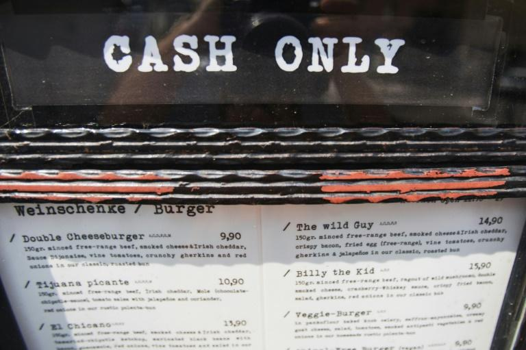 Some restaurants in Vienna advertise cash only (AFP Photo/ALEX HALADA)