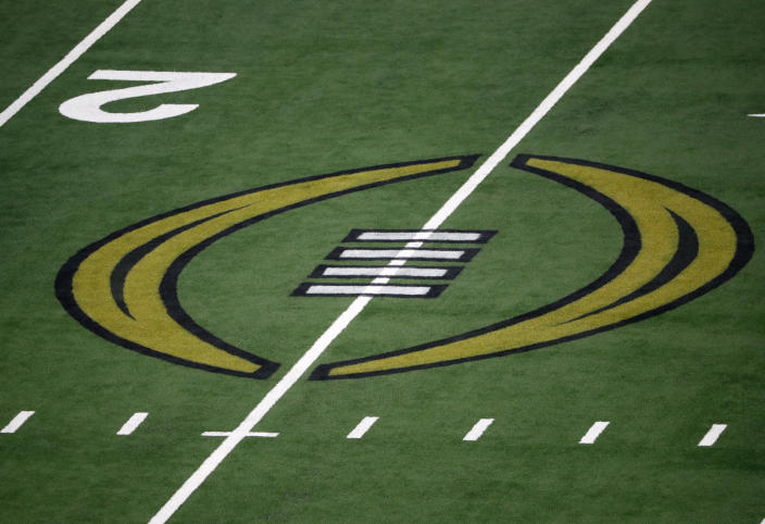 The College Football Championship Playoff logo is shown on the field at AT&T Stadium during the NCAA Cotton Bowl semi-final playoff football game between Clemson and Notre Dame on Saturday, Dec. 29, 2018, in Arlington, Texas. (AP Photo/Roger Steinman)