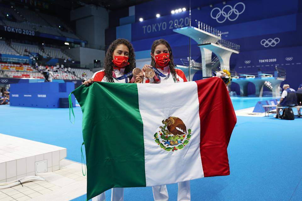 TOKYO, JAPAN - JULY 27: Bronze medalists Alejandra Orozco Loza and Gabriela Agundez Garcia of Team Mexico pose after the medal ceremony for the Women's Synchronised 10m Platform Final on day four of the Tokyo 2020 Olympic Games at Tokyo Aquatics Centre on July 27, 2021 in Tokyo, Japan. (Photo by Tom Pennington/Getty Images)
