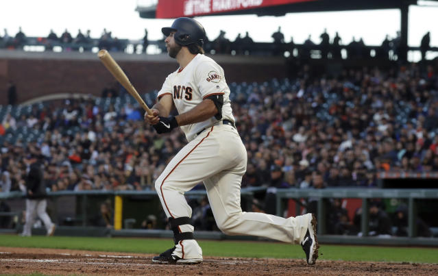 San Francisco Giants' Madison Bumgarner hits an RBI single against the Colorado Rockies during the fourth inning of a baseball game in San Francisco, Tuesday, June 25, 2019. (AP Photo/Jeff Chiu)