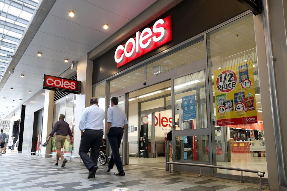 Coles store front with shoppers walking past.