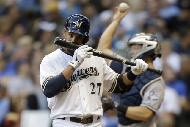 MILWAUKEE, WI - JULY 23: Carlos Gomez #27 of the Milwaukee Brewers smells his bat after fouling off a pitch in the bottom of the second inning against the San Diego Padres at Miller Park on July 23, 2013 in Milwaukee, Wisconsin. (Photo by Mike McGinnis/Getty Images)