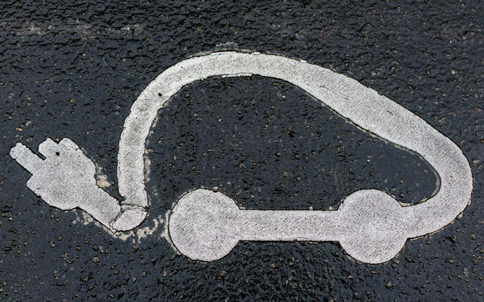 Electric car charging symbol  - Benjamin Girette /Bloomberg