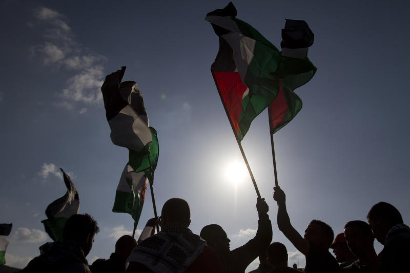 """File - In this March 30, 2012 file photo, Arab Israeli protesters wave Palestinians flags as they gather to mark the annual Land Day event in the Arab Village of Dir Hana, northern Israel. About 2,000 Israel's flourishing tech industry, where major global companies have offices and startups abound, has earned the country the nickname """"Startup Nation."""" But estimates put the number of Arabs in the industry at some 1,600, a jump from 350 workers in 2008 but still only about 2 percent of all Israeli tech workers. (AP Photo/Ariel Schalit, File)"""