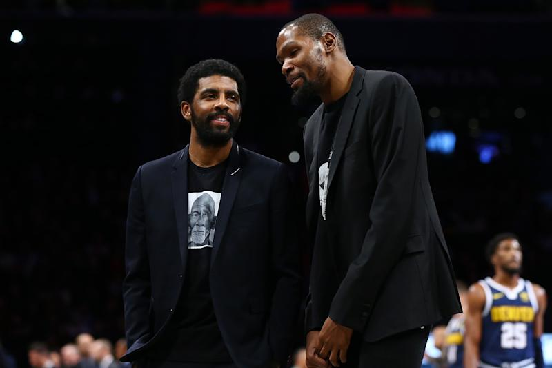 NEW YORK, NEW YORK - DECEMBER 08: Kevin Durant #7 and Kyrie Irving #11 of the Brooklyn Nets share a laugh during the game against the Denver Nuggets at Barclays Center on December 08, 2019 in New York City. Brooklyn Nets defeated the Denver Nuggets 105-102. NOTE TO USER: User expressly acknowledges and agrees that, by downloading and or using this photograph, User is consenting to the terms and conditions of the Getty Images License Agreement. Mandatory Copyright Notice: Copyright 2019 NBAE. (Photo by Mike Stobe/Getty Images)