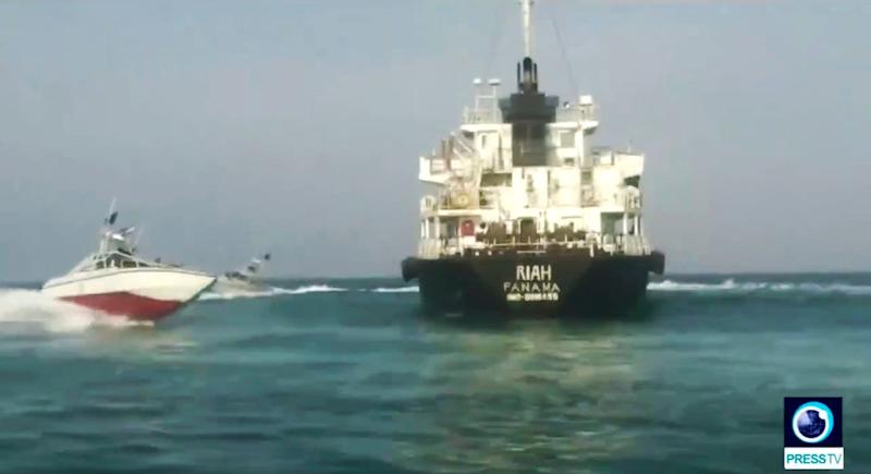 The Panamanian-flagged tanker MT Riah surrounded by the Iranian Revolutionary Guard. (AP)