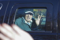 President Donald Trump waves to supporters as he departs after playing golf at the Trump National Golf Club in Sterling Va., Sunday Nov. 8, 2020. (AP Photo/Steve Helber)