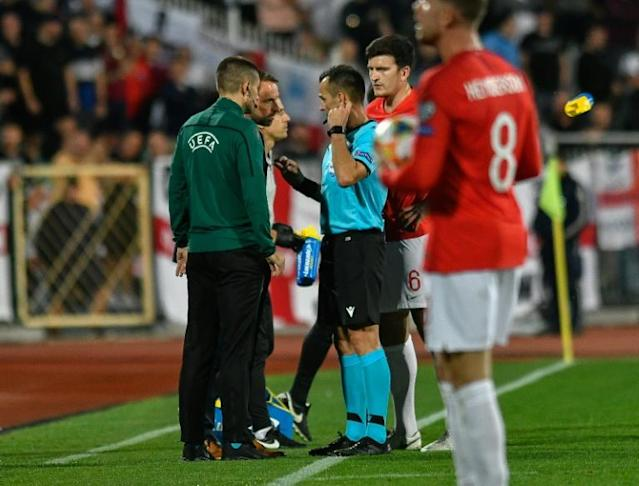 Croatian referee Ivan Bebek (centre) twice had to halt the match due to racist abuse (AFP Photo/NIKOLAY DOYCHINOV)
