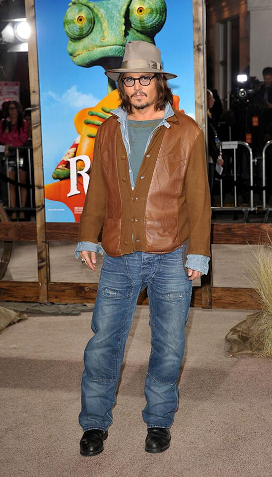 """<a href=""""http://movies.yahoo.com/movie/contributor/1800019485"""">Johnny Depp</a> attends the Los Angeles premiere of <a href=""""http://movies.yahoo.com/movie/1810079248/info"""">Rango</a> on February 14, 2011."""