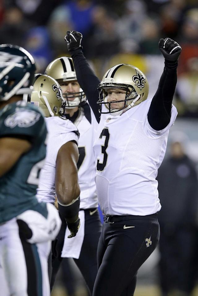 New Orleans Saints' Shayne Graham celebrates after kicking the game-winning field goal during the second half of an NFL wild-card playoff football game against the Philadelphia Eagles, Saturday, Jan. 4, 2014, in Philadelphia. New Orleans won 26-24. (AP Photo/Michael Perez)