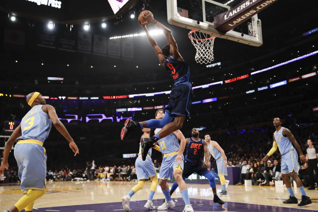 Five Lakers watch as Thunder forward Jerami Grant dunks uncontested. (AP)
