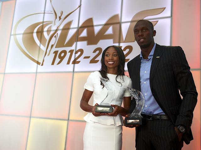 BARCELONA, SPAIN - NOVEMBER 24: Allyson Felix (L) of the United States and Usain Bolt of Jamaica pose with their female and male 2012 World Athletes of the Year awards during the IAAF athlete of the year award at the IAAF Centenary Gala on November 24, 2012 in Barcelona, Spain. (Photo by Manuel Queimadelos Alonso/Getty Images)