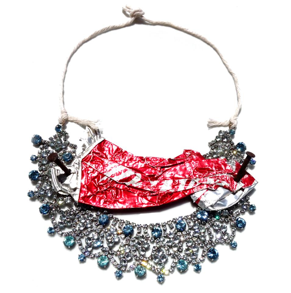 """<p>Make an eco statement with this cheeky necklace. Who knew being green could also be fashionable?</p><p>Buy it <a rel=""""nofollow"""" href=""""http://www.akatombinns.com/contact.html"""">here</a> for Price Upon Request.</p>"""