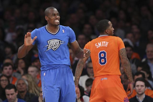 Oklahoma City Thunder power forward Serge Ibaka (9) reacts after drawing a foul on New York Knicks shooting guard J.R. Smith (8) during the first half of their NBA basketball game at Madison Square Garden, Wednesday, Dec. 25, 2013, in New York. (AP Photo/John Minchillo)