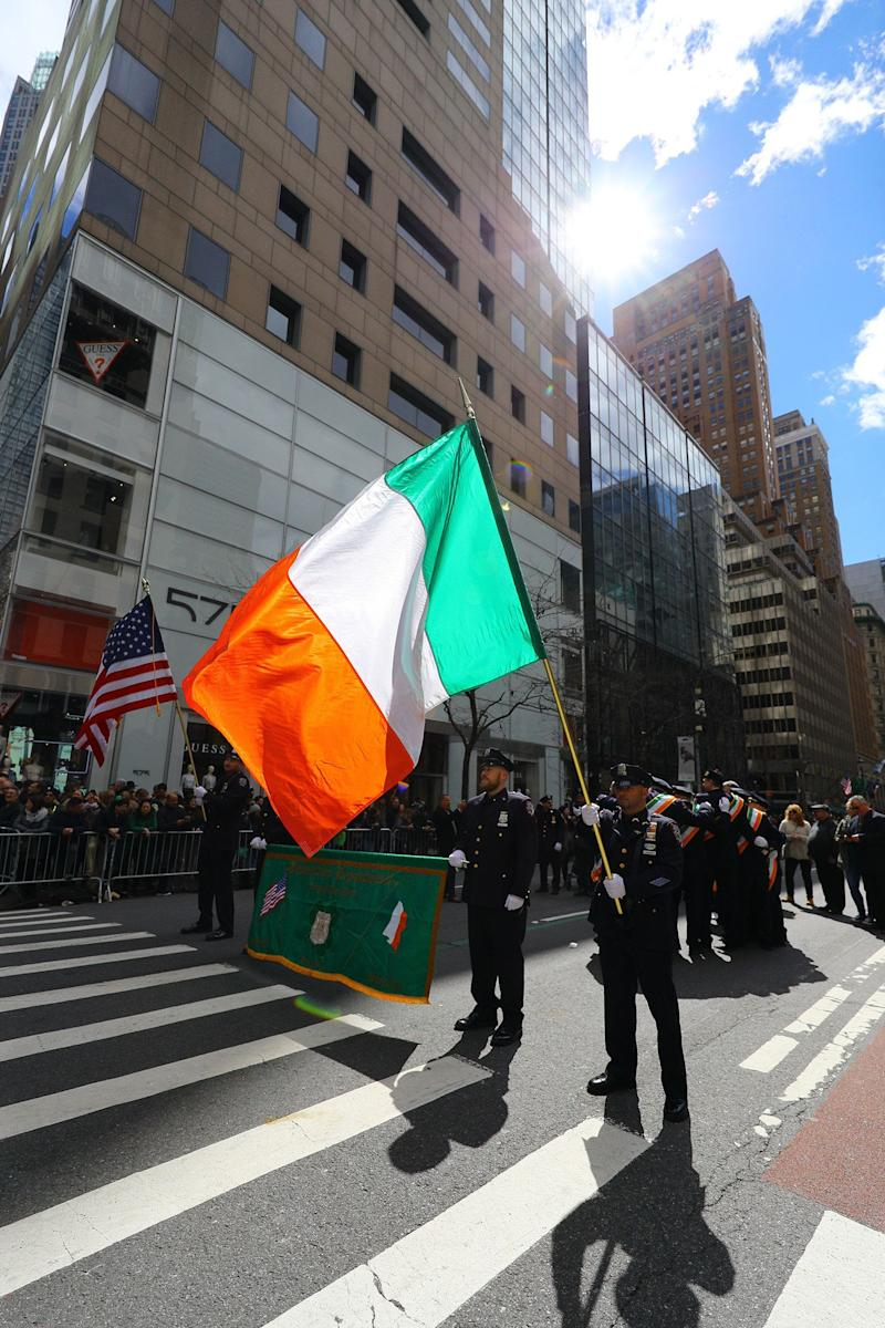 A flag of Ireland passes through the sunlight during the St. Patrick's Day Parade on March 16, 2019, in New York. (Photo: Gordon Donovan/Yahoo News)