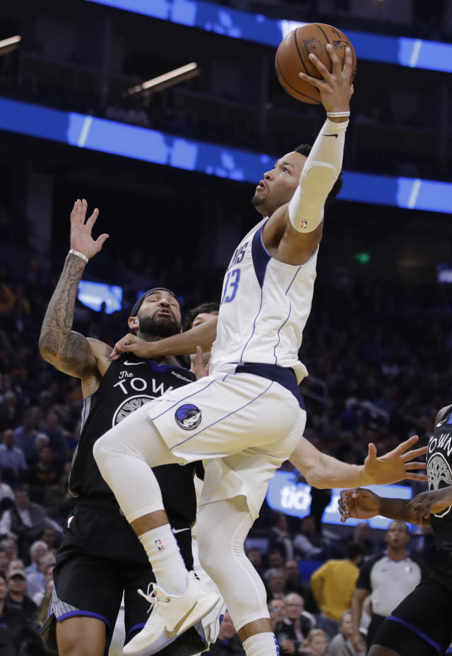 Dallas Mavericks' Jalen Brunson, right, shoots over Golden State Warriors' Willie Cauley-Stein during the first half of an NBA basketball game Tuesday, Jan. 14, 2020, in San Francisco. (AP Photo/Ben Margot)