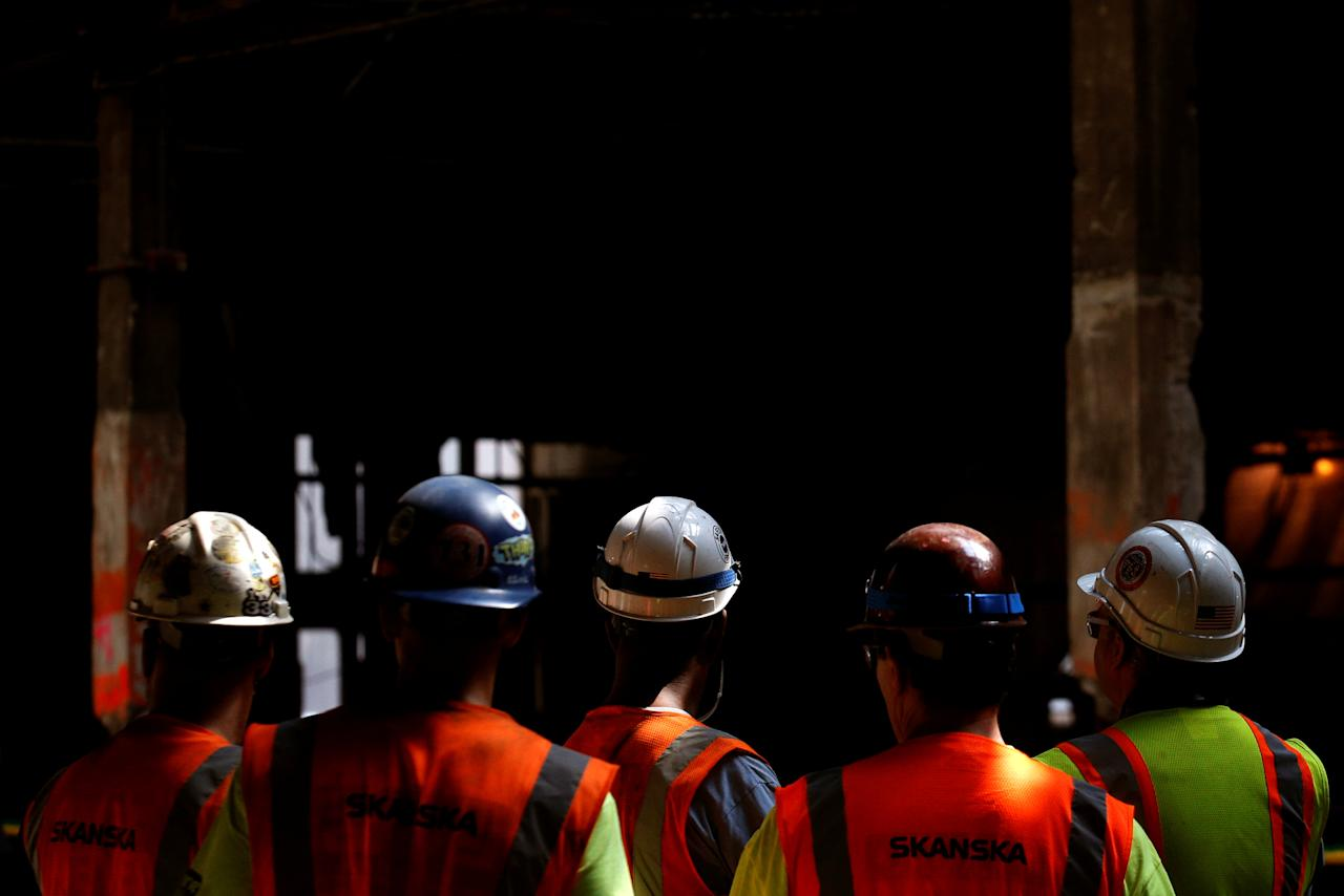 Construction workers attend an announcement by New York Governor Andrew Cuomo at The Moynihan Train Hall in New York City, U.S., August 17, 2017. REUTERS/Brendan McDermid