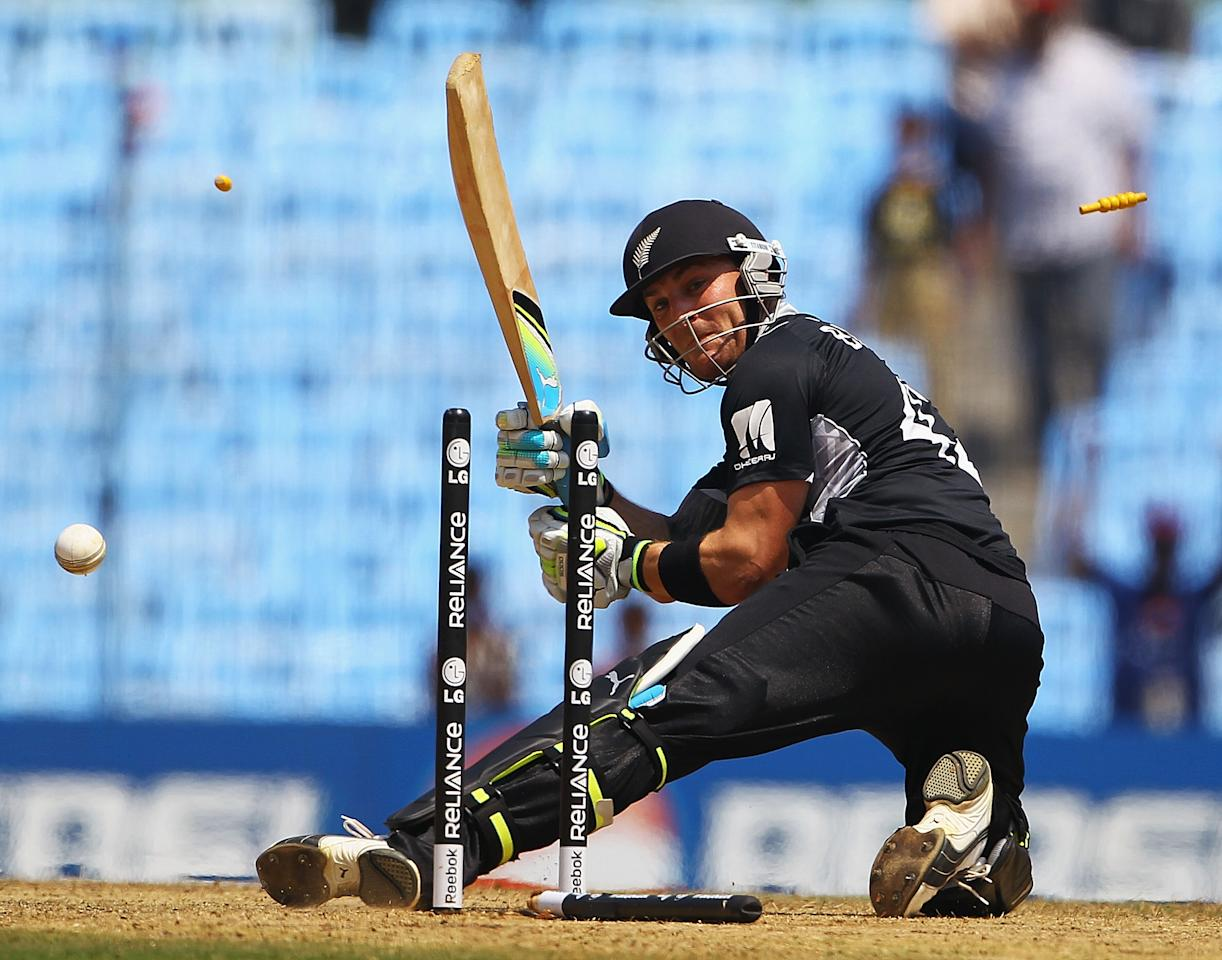 CHENNAI, INDIA - FEBRUARY 20:  Brendon McCullum looks to lift the ball over the wicket keeper on a free hit, but is bowled by Nehemiah Odhiambo of Kenya during the 2011 ICC World Cup Group A match between Kenya and New Zealand at M. A. Chidambaram Stadium on February 20, 2011 in Chennai, India.  (Photo by Matthew Lewis/Getty Images)