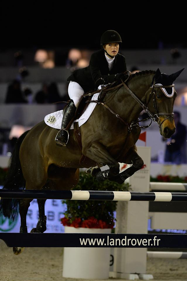 PARIS, FRANCE - DECEMBER 05: Jennifer Gates rides Unique during the Invitational Trophy at the Gucci Paris Masters 2013 on December 5, 2013 in Paris, France. (Photo by Pascal Le Segretain/Getty Images)
