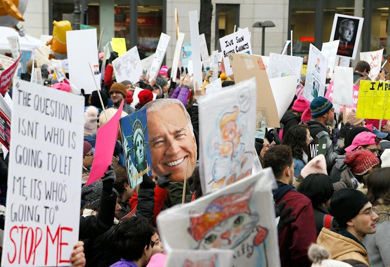 WASHINGTON, DC - JANUARY 19: Demonstrators display their signs, including a cut-out of former VP Joe Biden (C) who may make a bid for the presidency in 2020, during the 2019 Women's March on January 19, 2019 in Washington, DC. Thousands of women gathered in the US capital and across the country to support women's rights and to oppose President Donald Trump's policies. (Photo by Paul Morigi/Getty Images)