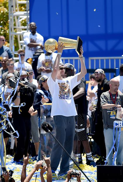 OAKLAND, CA - JUNE 19:  Klay Thompson #11 of the Golden State Warriors holding the Larry O'Brien Trophy celebrates with his teammates at The Henry J. Kaiser Convention Center during thier Victory Parade and Rally on June 19, 2015 in Oakland, California.  (Photo by Thearon W. Henderson/Getty Images)