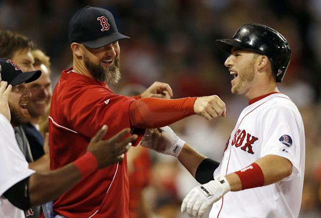 Boston Red Sox's Stephen Drew, right, celebrates his two-run home run with teammates including David Ross, center, in the second inning of a baseball game in Boston, Thursday, Sept. 19, 2013. (AP Photo/Michael Dwyer)