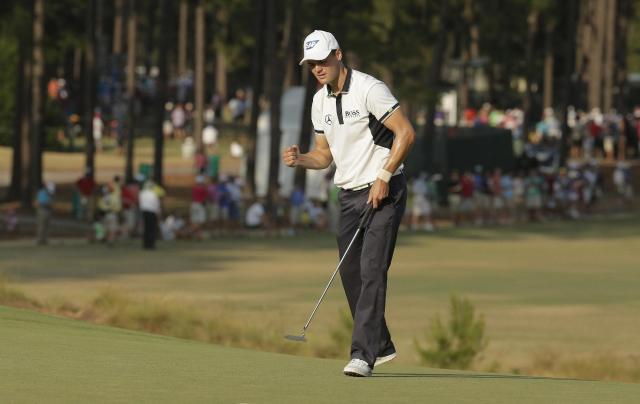 Martin Kaymer, of Germany, reacts to his putt on the 13th hole during the final round of the U.S. Open golf tournament in Pinehurst, N.C., Sunday, June 15, 2014. (AP Photo/Charlie Riedel)