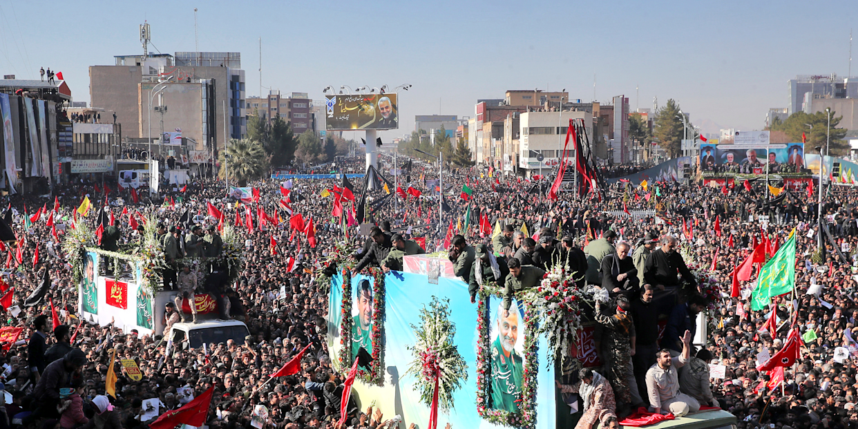 Coffins of Gen. Qassem Soleimani and others who were killed in Iraq by a U.S. drone strike, are carried on a truck surrounded by mourners during a funeral procession, in the city of Kerman, Iran, Tuesday, Jan. 7, 2020.