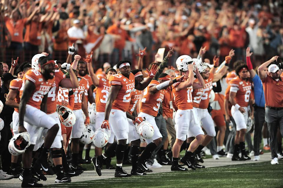 AUSTIN, TX - NOVEMBER 09: The Texas Longhorns sideline reacts to the game winning field goal as time expires to give them a 27 - 24 win over the Kansas State Wildcats on November 9, 2019 at Darrell K Royal-Texas Memorial Stadium in Austin, Texas. (Photo by John Rivera/Icon Sportswire via Getty Images)