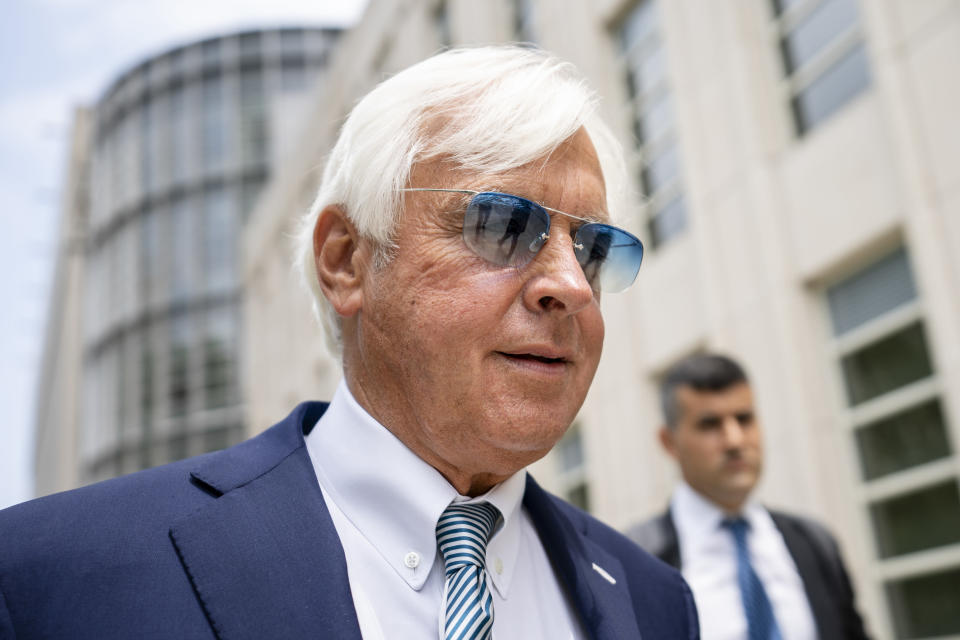 FILE - In this Monday July 12, 2021 file photo, horse trainer Bob Baffert leaves federal court in the Brooklyn borough of New York. A New York federal judge on Wednesday, July 14, 2021 nullified the suspension of horse trainer Bob Baffert, finding that the New York Racing Association acted unconstitutionally by failing to let him adequately respond to claims made against him after Kentucky Derby winner Medina Spirit failed a postrace drug test. (AP Photo/John Minchillo, File)