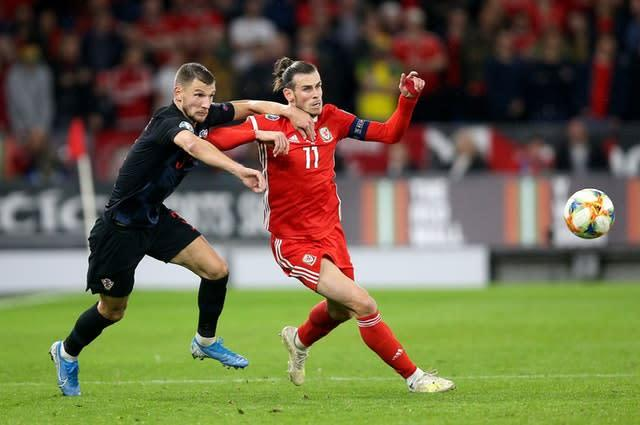 Croatia's Borna Barisic (left) and Wales' Gareth Bale battle for the ball (Nigel French/PA)