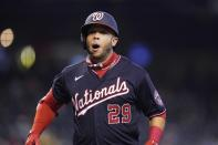 Washington Nationals' Yadiel Hernandez shouts as he arrives at home plate after hitting a home run against the Arizona Diamondbacks during the eighth inning of a baseball game Sunday, May 16, 2021, in Phoenix. (AP Photo/Ross D. Franklin)