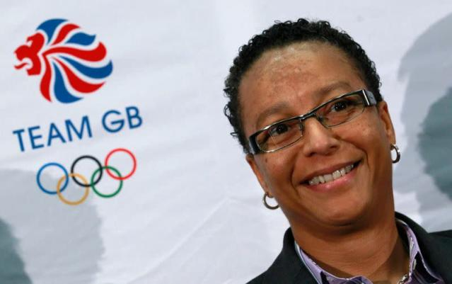 Former England women's soccer coach Hope Powell smiles during a news conference at Wembley Stadium in London