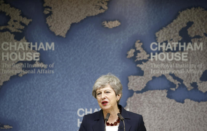 """Britain's Prime Minister Theresa May speaks at Chatham House in London, Wednesday July 17, 2019. Prime Minister Theresa May says she worries about the increasing """"absolutism"""" of world politics, in a message many will see as aimed at her successor as Britain's leader and President Donald Trump. (Henry Nicholls/Pool via AP)"""