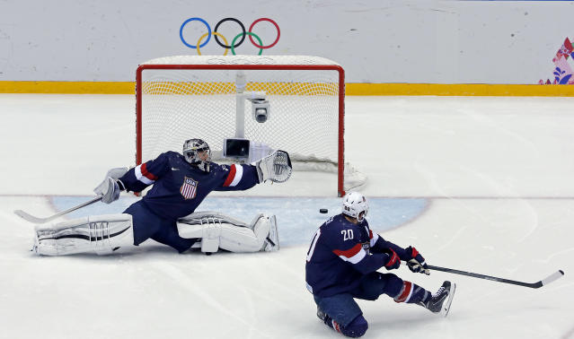 USA goaltender Jonathan Quick and defenseman can't stop a goal by Finland's Sami Salo of the men's bronze medal ice hockey game at the 2014 Winter Olympics, Saturday, Feb. 22, 2014, in Sochi, Russia. (AP Photo/David J. Phillip )
