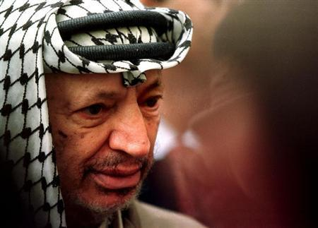 PLO chairman Yasser Arafat listens to journalists at the National Assembly after a meeting with Speaker Laurent Fabius. PW/JDP
