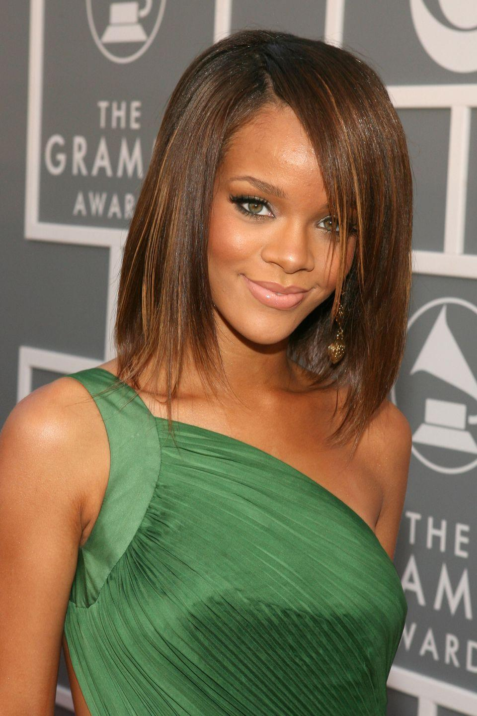 <p>Rihanna's bob turns into a layered lob, complete with caramel highlights. </p>