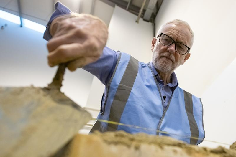 NOTTINGHAM, ENGLAND - NOVEMBER 25: Labour leader Jeremy Corbyn lays a brick during a visit to West Nottinghamshire College Construction Centre on November 25, 2019 in Nottingham, England. A day after Prime Minister Boris Johnson launched the Conservative manifesto, Jeremy Corbyn is expected to announce Labour's housing policy. (Photo by Leon Neal/Getty Images)